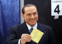 Former Prime Minister Silvio Berlusconi smiles as he casts his vote at the polling station in Milan, February 24, 2013. Italians began voting on Sunday in one of the most closely watched elections in years, with markets nervous about whether it can produce a strong government to pull Italy out of recession and help resolve the euro zone debt crisis. REUTERSStefano Rellandini  (ITALY - Tags: POLITICS ELECTIONS) ITALY-VOTE