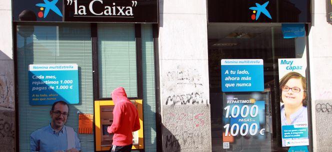Caixabank solo el 9 de transacciones se hace ya en for Oficinas caixabank madrid