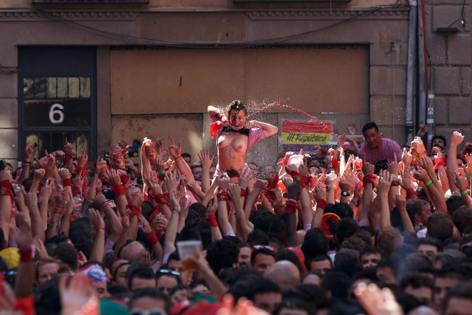 PAMPLONA, SPAIN - JULY 06: (EDITORS NOTE: Image contains nudity) Revellers enjoy the atmosphere during the opening day or 'Chupinazo' of the San Fermin Running of the Bulls fiesta on August 6, 2016 in Pamplona, Spain. The annual Fiesta de San Fermin, made famous by the 1926 novel of US writer Ernest Hemmingway entitled 'The Sun Also Rises', involves the daily running of the bulls through the historic heart of Pamplona to the bull ring. (Photo by Pablo Blazquez DominguezGetty Images)