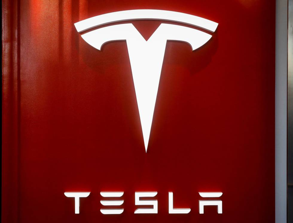 The Tesla logo is seen at the entrance to Tesla Motors' new showroom in Manhattan's Meatpacking District in New York City, U.S., December 14, 2017. REUTERSBrendan McDermid