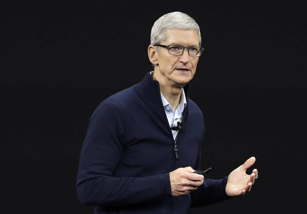 FILE- In this Sept. 12, 2017, file photo, Apple CEO Tim Cook, shows new Apple Watch Series 3 product at the Steve Jobs Theater on the new Apple campus in Cupertino, Calif. Cook is leaving shareholders in suspense about whether the iPhone maker will use its windfall from a tax cut on overseas profits for a big boost to its quarterly dividend. (AP PhotoMarcio Jose Sanchez, File)