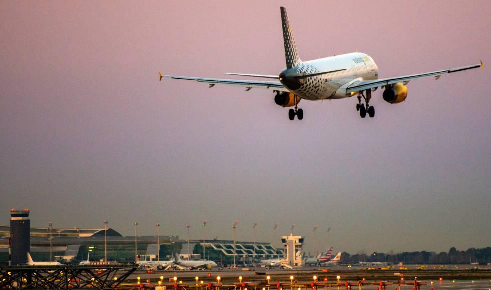 A Vueling plane lands at the Barcelona-El Prat airport.
